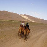 camel riding tourists, mongolia travel, premium travel